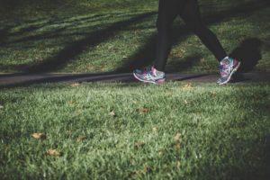 photo of legs walking on a grassy footpath