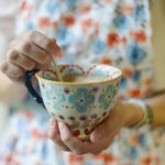 woman holding a tea cup